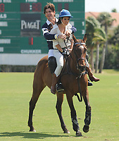 WEST PALM BEACH, FL - MARCH 14:  Kourtney Kardashian and Scott Disick with their young son Mason Dash Disick in tow take a polo lesson with top ranked american polo player Nic Roldan. The couple was joined by sister Khloe Kardashian. The kardashian clan had a great afternoon, riding horses and joking around while they sipped champagne at the International polo club palm beach on March 14, 2010 in Wellington, Florida.<br /> <br /> <br /> People:  Nic Roldan, Kourtney Kardashian