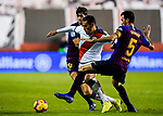 Alexander Alegria Moreno, Alex Alegria, of Rayo Vallecano (C) is tackled by Sergio Busquets Burgos (R) and Sergi Roberto Carnicer, S Roberto, of FC Barcelona during the La Liga 2018-19 match between Rayo Vallecano and FC Barcelona at Estadio de Vallecas, on November 03 2018 in Madrid, Spain. Photo by Diego Gouto / Power Sport Images