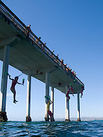 August 5 2009, Ocean Beach San Diego CA USA:   San Diego Junior Lifeguards prove their courage with a giant leap from the Ocean Beach Pier into the turbulent waters below.
