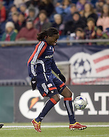 New England Revolution midfielder Shalrie Joseph (21) controls the ball at midfield. The New England Revolution tied the Chicago Fire, 0-0, at Gillette Stadium on October 17, 2009.