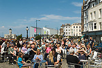 Margate Kent The Parade, tourist Sunday afternoon enjoy free musical entertainment,  The Turner Contemporary Art gallery in background.