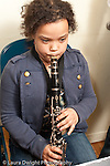 private instrumental lessons at public elementary school with music enrichment through public-private partnership girl playing the clarinet