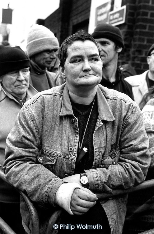 A homeless woman with a broken arm waits for the opening of the Crisis 'Open Christmas' shelter in Bermondsey, South London.