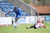 Kwame Poku of Colchester skips the challenge from Piergianni of Oldham Athletic during Colchester United vs Oldham Athletic, Sky Bet EFL League 2 Football at the JobServe Community Stadium on 3rd October 2020