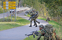 Dutch soldier look for enemy troops during NATO exercise Noble Ledger in Norway. The NATO Response Force (NRF) is a multinational force made up of land, air, maritime and Special Operations Forces components. The exercise includes around 6500 soldiers from the USA, Germany, Netherlands, Denmark, Belgium and Norway. Photo: Fredrik Naumann/Panos Pictures