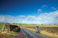 A cyclist cycling near Eaglesham, East Renfrewshire