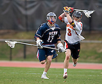 Jake Bernhardt (3) of Maryland tries to take the ball away from Joe Kelly (17) of Penn at Ludwig Field in College Park, Maryland.