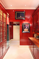 The red kitchen is a new edition to the house, built by architect Craig Hamilton