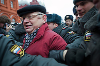 Moscow, Russia, 04/12/2011..Police arrest a protester as Russian opposition supporters demonstrate on Manezhnaya square outside the Kremlin calling for a boycott of the parliamentary elections.