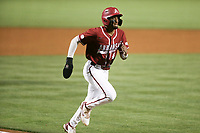 Arkansas infielder Jalen Battles (4) runs home for a score, Saturday, June 5, 2021 in the second game of the NCAA Fayetteville Regional at Baum-Walker Stadium in Fayetteville. Check out nwaonline.com/210606Daily/ for today's photo gallery. <br /> (NWA Democrat-Gazette/Charlie Kaijo)
