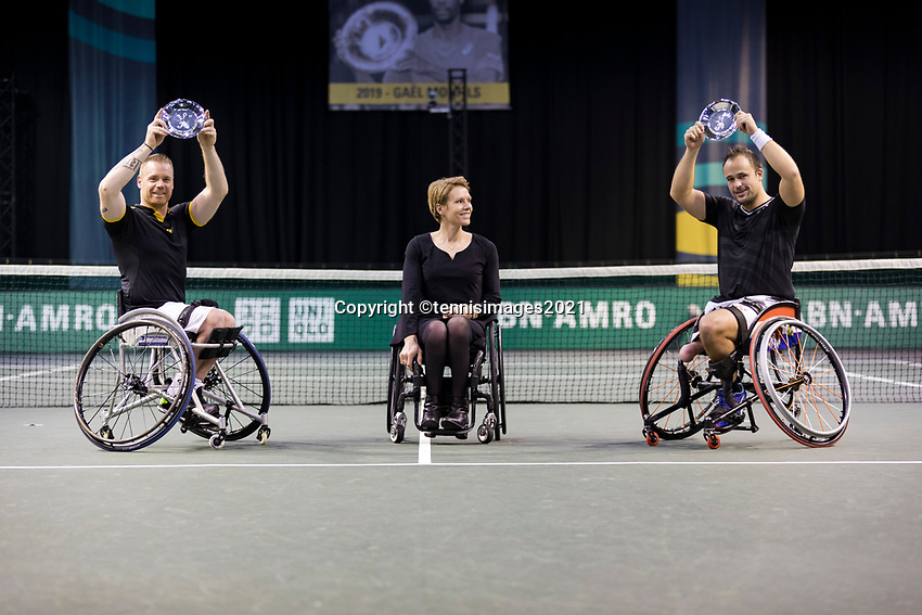 Rotterdam, The Netherlands,7 march  2021, ABNAMRO World Tennis Tournament, Ahoy,  <br /> Doubles Final Wheelchair: Finalists Alfie Hewett (GBR) (R) / Gordon Reid (GBR) (L) receive price at inaugration from Esther Vergeer (NED).<br /> Photo: www.tennisimages.com/henkkoster