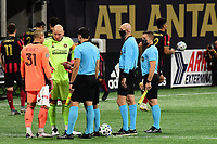 ATLANTA, GA - SEPTEMBER 02: Captains Brad Guzan #1 of Atlanta United FC and Luis Robles #31 of Inter Miami CF meet with officials for the coin toss during a game between Inter Miami CF and Atlanta United FC at Mercedes-Benz Stadium on September 02, 2020 in Atlanta, Georgia.