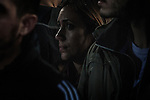 Athens, Greece, January 22, 2015. A worried greek voter listening to Alexis Tsipras during the final political rally for Syriza.