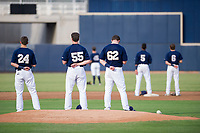 Nick Egnatuk (24), Brendan Murphy (55), and Pat McInerney (62) of the AZL Brewers during the National Anthem before a game against the AZL Padres 2 on September 2, 2017 at Maryvale Baseball Park in Phoenix, Arizona. AZL Brewers defeated the AZL Padres 2 2-0. (Zachary Lucy/Four Seam Images)