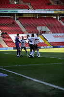 24th April 2021; The Valley, London, England; English Football League One Football, Charlton Athletic versus Peterborough United; Posh players celebrate the penalty save from on loan keeper Josef Bursik in the 30th minute from Charltons Jayden Stockley