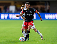 WASHINGTON, DC - MAY 13: Andy Najar #14 of D.C. United dribbles the ball during a game between Chicago Fire FC and D.C. United at Audi FIeld on May 13, 2021 in Washington, DC.