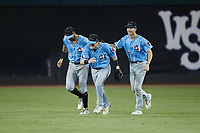 Hickory Crawdads outfielders Jake Guenther (17), Kellen Strahm (33) and Pedro Gonzalez (4) celebrate their extra inning win over the Winston-Salem Dash at Truist Stadium on July 10, 2021 in Winston-Salem, North Carolina. (Brian Westerholt/Four Seam Images)