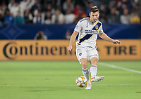 CARSON, CA - SEPTEMBER 21: Dave Romney #4 of the Los Angeles Galaxy crosses a ball during a game between Montreal Impact and Los Angeles Galaxy at Dignity Health Sports Park on September 21, 2019 in Carson, California.