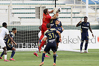 CARY, NC - AUGUST 01: Alex Tambakis #1 grabs a cross off of the head of teammate Robert Kristo #11 during a game between Birmingham Legion FC and North Carolina FC at Sahlen's Stadium at WakeMed Soccer Park on August 01, 2020 in Cary, North Carolina.