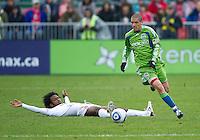 25 April 2010: Toronto FC midfielder Julian de Guzman #6 tries to slide tackle Seattle Sounders midfielder Osvaldo Alonso #6 during a game between the Seattle Sounders and Toronto FC at BMO Field in Toronto..Toronto FC won 2-0....