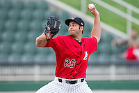 Kannapolis Intimidators relief pitcher Dylan Chavez (29) in action against the Greenville Drive at CMC-Northeast Stadium on April 6, 2014 in Kannapolis, North Carolina.  The Intimidators defeated the Drive 8-5.  (Brian Westerholt/Four Seam Images)