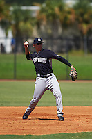 GCL Yankees 1 third baseman Donny Sands (89) warmup throw to first during the first game of a doubleheader against the GCL Tigers on August 5, 2015 at Tigertown in Lakeland, Florida.  GCL Tigers derated the GCL Yankees 5-2.  (Mike Janes/Four Seam Images)