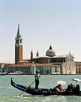 A gondolier glides gently passed the island of San Giorgio Maggiore in Venice.