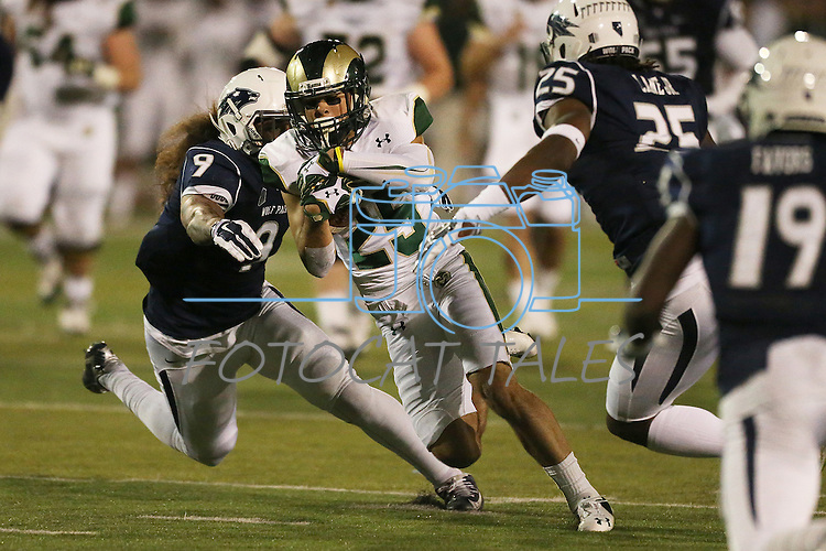 Colorado State's Joe Hansley (25) runs through Nevada defenders Matthew Lyons (9) and Bryan Lane Jr. (25) during the first half of an NCAA college football game in Reno, Nev., on Saturday, Oct. 11, 2014. (AP Photo/Cathleen Allison)