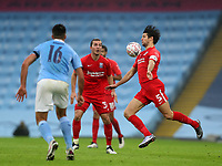 10th January 2021; Etihad Stadium, Manchester, Lancashire, England; English FA Cup Football, Manchester City versus Birmingham City; George Friend of Birmingham City controls the ball with his chest under pressure from Rodri of Manchester City