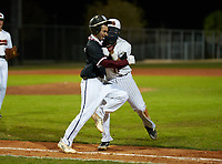 Riverview Rams Dylan Wilds (5) is tagged out by first baseman Daniel Torrealba (11) during a game against the Sarasota Sailors on February 19, 2021 at Rams Baseball Complex in Sarasota, Florida. (Mike Janes/Four Seam Images)