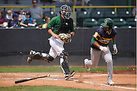 Clinton LumberKings James Alfonso (12) chases Beloit's Jesus Lopez (7) after a third strike during the Midwest League game against the Beloit Snappers at Ashford University Field on June 12, 2016 in Clinton, Iowa.  The LumberKings won 1-0.  (Dennis Hubbard/Four Seam Images)