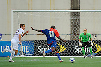 United States (USA) goalkeeper Luis Robles (18) watches as Fabrice Noel (11) of Haiti (HAI) takes a shot. The United States and Haiti played to a 2-2 tie during a CONCACAF Gold Cup Group B group stage match at Gillette Stadium in Foxborough, MA, on July 11, 2009. .