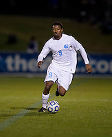 Jordan McCrary (9) of North Carolina brings the ball upfield during the game at the Maryland SoccerPlex in Germantown, MD. North Carolina defeated Virginia on penalty kicks after playing to a 0-0 tie in regulation time.  With the win the Tarheels advanced to the finals of the ACC men's soccer tournament.
