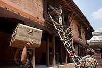 Nepali Army special force taking out a box full with antique items from a destroyed museum in Changu village,  Bhaktapur, outside of Kathmandu, Nepal. May 05, 2015