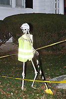 Life-sized skeletons are dressed up for Halloween decorations along Hillcrest Road in Belmont, Massachusetts, USA, on Mon., Oct. 30, 2017. A resident said the neighborhood has been doing similar coordinated decorations along the road for the previous 3 or 4 years. In this image, the skeleton is dressed as a construction worker.