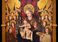 Virgin Mary; Mother of God; The Virgin; Mare de deu; Gothic altarpiece of Madonna and Child by Joan Reixach of Barcelona, circa 1450, tempera and gold leaf on wood, from the sanctuary of San Pau d'Albocasser, Castello..  National Museum of Catalan Art, Barcelona, Spain, inv no: MNAC  64055. Against a black background.