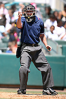 April 15, 2009:  Home plate umpire Sean Barber during a game at Roger Dean Stadium in Jupiter, FL.  Photo by:  Mike Janes/Four Seam Images