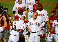Jun. 8, 2012; Phoenix, AZ, USA; Arizona Diamondbacks third baseman Ryan Roberts is congratulated by manager Kirk Gibson after hitting a three run walk off home run in the ninth inning against the Oakland Athletics at Chase Field.  Mandatory Credit: Mark J. Rebilas-
