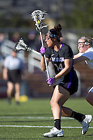 University at Albany midfielder Ariana Parker (14) on the attack as Boston College midfielder Jessie Coffield (15) defends. University at Albany defeated Boston College, 11-10, at Newton Campus Field, on March 30, 2011.
