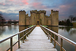 United Kingdom, England, East Sussex, View over moat to Bodiam Castle at dawn in winter