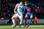 Maxi Gomez of RC Celta de Vigo (L) in action against Gerard Pique Bernabeu of FC Barcelona (R) during the La Liga 2017-18 match between FC Barcelona and RC Celta de Vigo at Camp Nou Stadium on 02 December 2017 in Barcelona, Spain. Photo by Vicens Gimenez / Power Sport Images