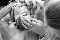 Female sculptor working on her sculpture.