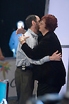 Greenstein gets a hug from announcer, Linda Johnson.