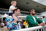 ARLINGTON HEIGHTS, IL - AUGUST 12: A toddler sits on his father's shoulders while watching undercard races on Arlington Million Day at Arlington Park on August 12, 2017 in Arlington Heights, Illinois. (Photo by Jon Durr/Eclipse Sportswire/Getty Images)