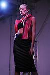 A model walks the runway at the Light as Air Fashion show with leather fashions by Jose Sanchez and performances by Vault with Choreography by Amy Eli at Vault Houston Saturday Jan.10, 2015.(Dave Rossman For the Chronicle)