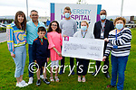 The O'Donoghue family from Killorglin present a cheque for  €6,885 to the Cardiac Rehabilitation Centre at UHK on Monday. L to r: Laura, Joseph, Joshua and Isabella O'Donoghue, Donnacha Walsh, Sadie Evans, Dr Hadim Yagoub and Kay Karim.