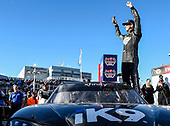 #18: Kyle Busch, Joe Gibbs Racing, Toyota Supra Extreme Concepts/iK9, celebrates after winning the NASCAR Xfinity Series race.