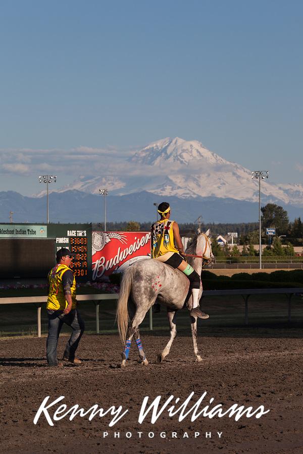 Chaz Racine Riding Red Painted Grey Horse, Team Carson, Battle of Horse Nation, Indian Horse Relay Racing, Emerald Downs, Auburn, Washington, WA, America, USA.