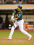 Coco Crisp drives in the game winning run.<br /> Boston Red Sox at Oakland A's at O.Co coliseum in Oakland, June 20, 2014