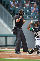 Home plate umpire Adam Beck makes a strike call during the International League game between the Buffalo Bisons and the Caballeros de Charlotte at BB&T BallPark on July 23, 2019 in Charlotte, North Carolina. The Bisons defeated the Caballeros 8-1. (Brian Westerholt/Four Seam Images)